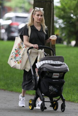 Emma Roberts - Seen with baby Rhodes in Boston