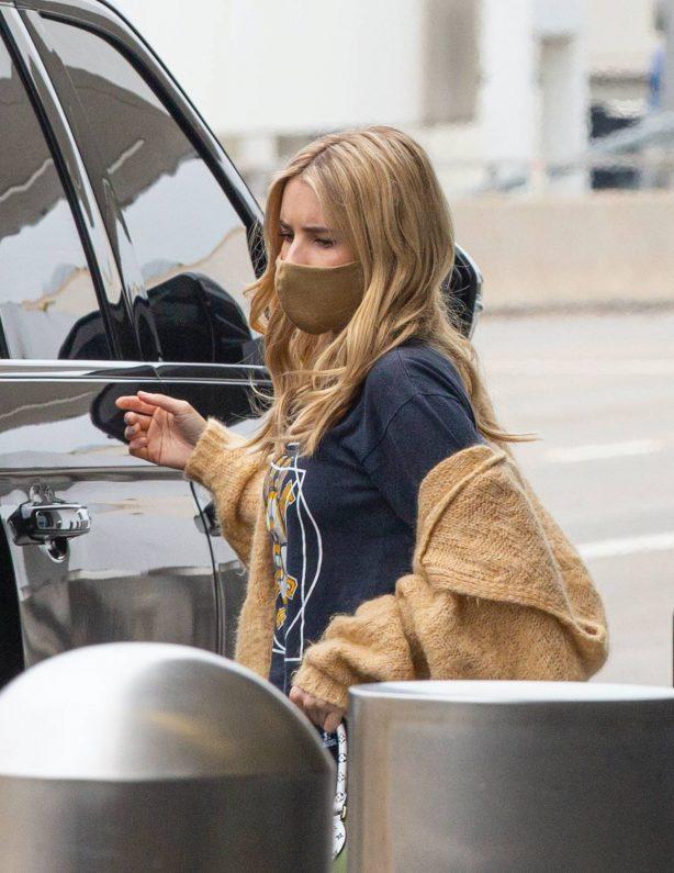 Emma Roberts with Garrett Hedlund - Seen at LAX in Los Angeles