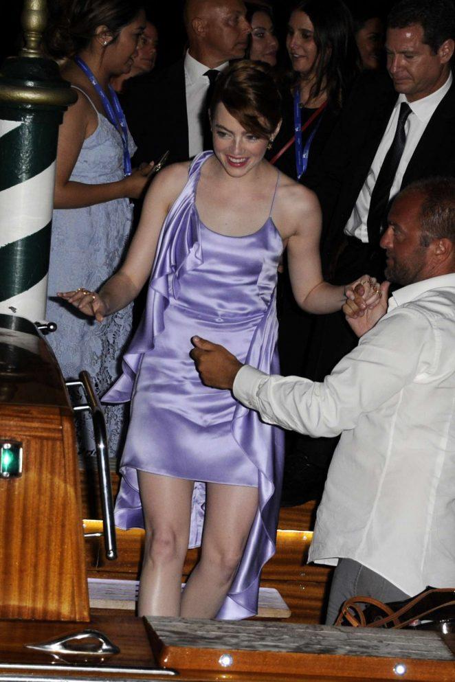 Emma Stone boarding a private water taxi in Venice