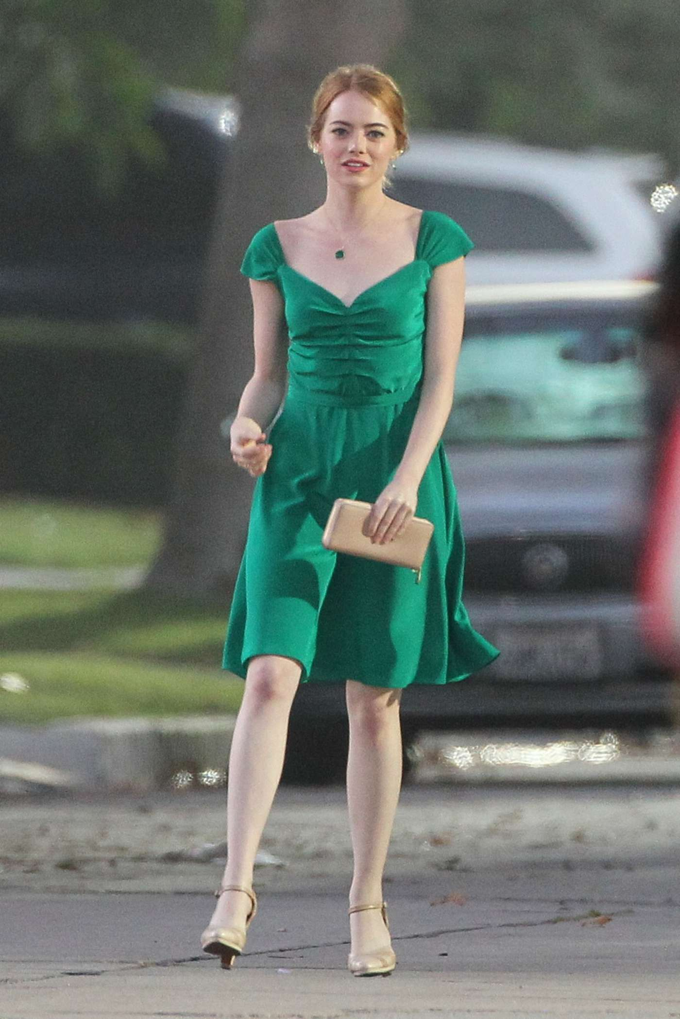 http://www.gotceleb.com/wp-content/uploads/photos/emma-stone/filming-la-la-land-in-los-angeles/Emma-Stone-in-Green-Dress-on-La-La-Land--03.jpg