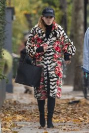 Emma Watson in a mixed print fur coat as she heads to pilates class in London
