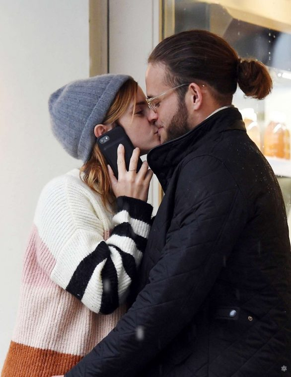 Emma Watson - Shares a kiss with mystery man in London