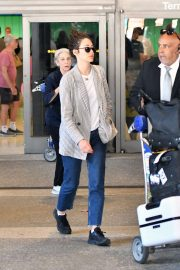 Emmy Rossum - Arrives at LAX International Airport in LA