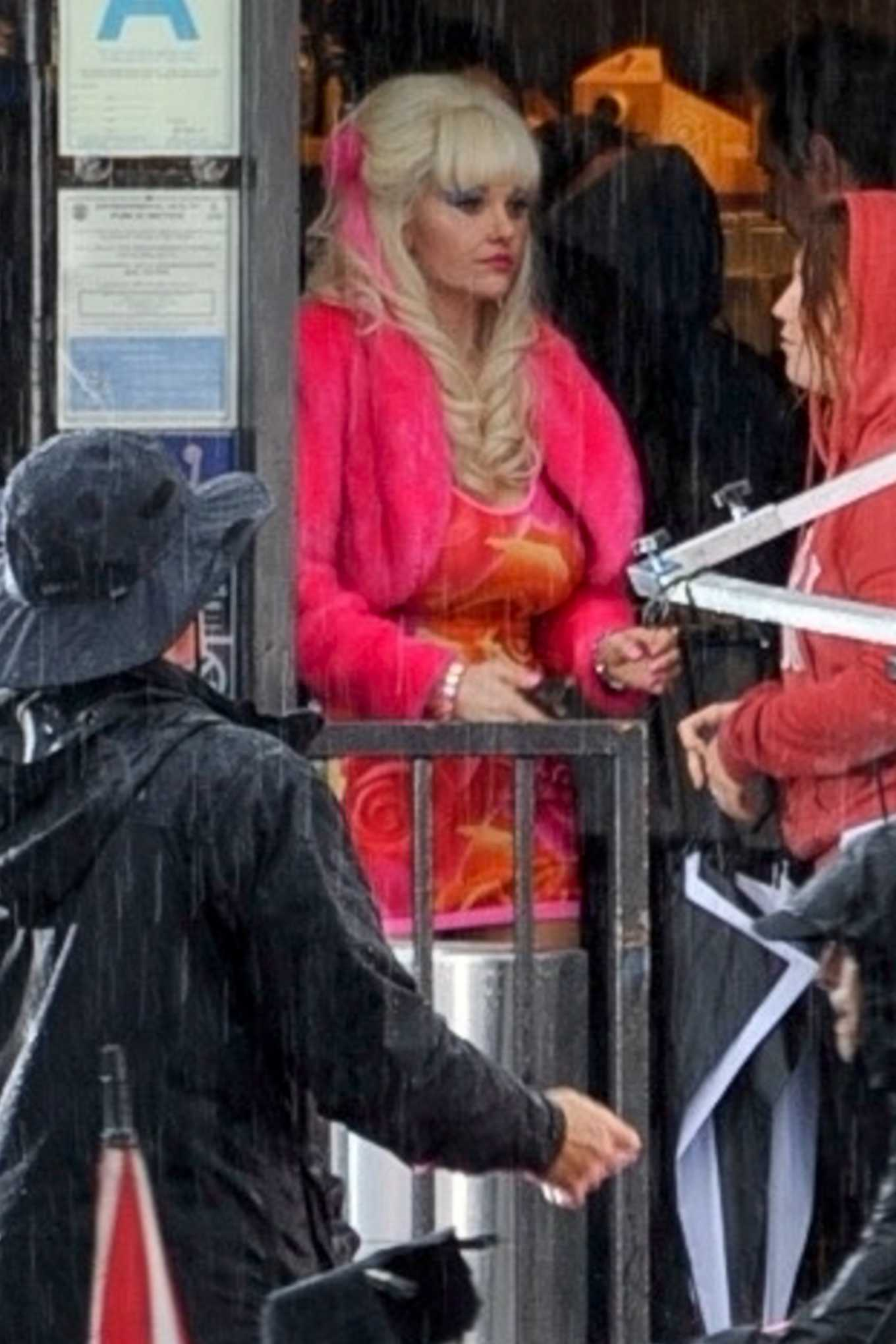 Emmy Rossum on the set of 'Angelyne' on a rainy day in LA