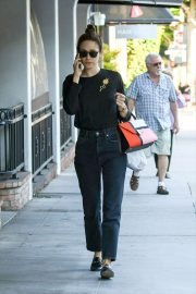 Emmy Rossum - Talking on her cell phone in Los Angeles