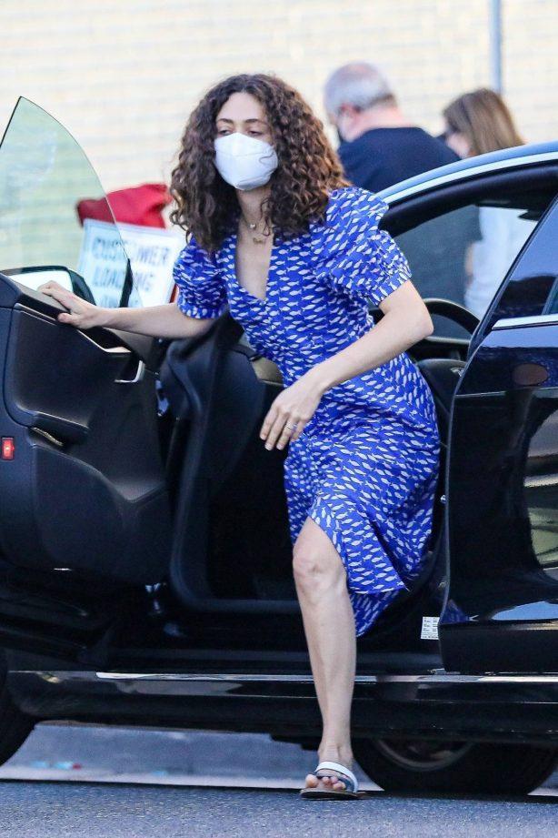 Emmy Rossum wearing a bright blue dress in Beverly Hills