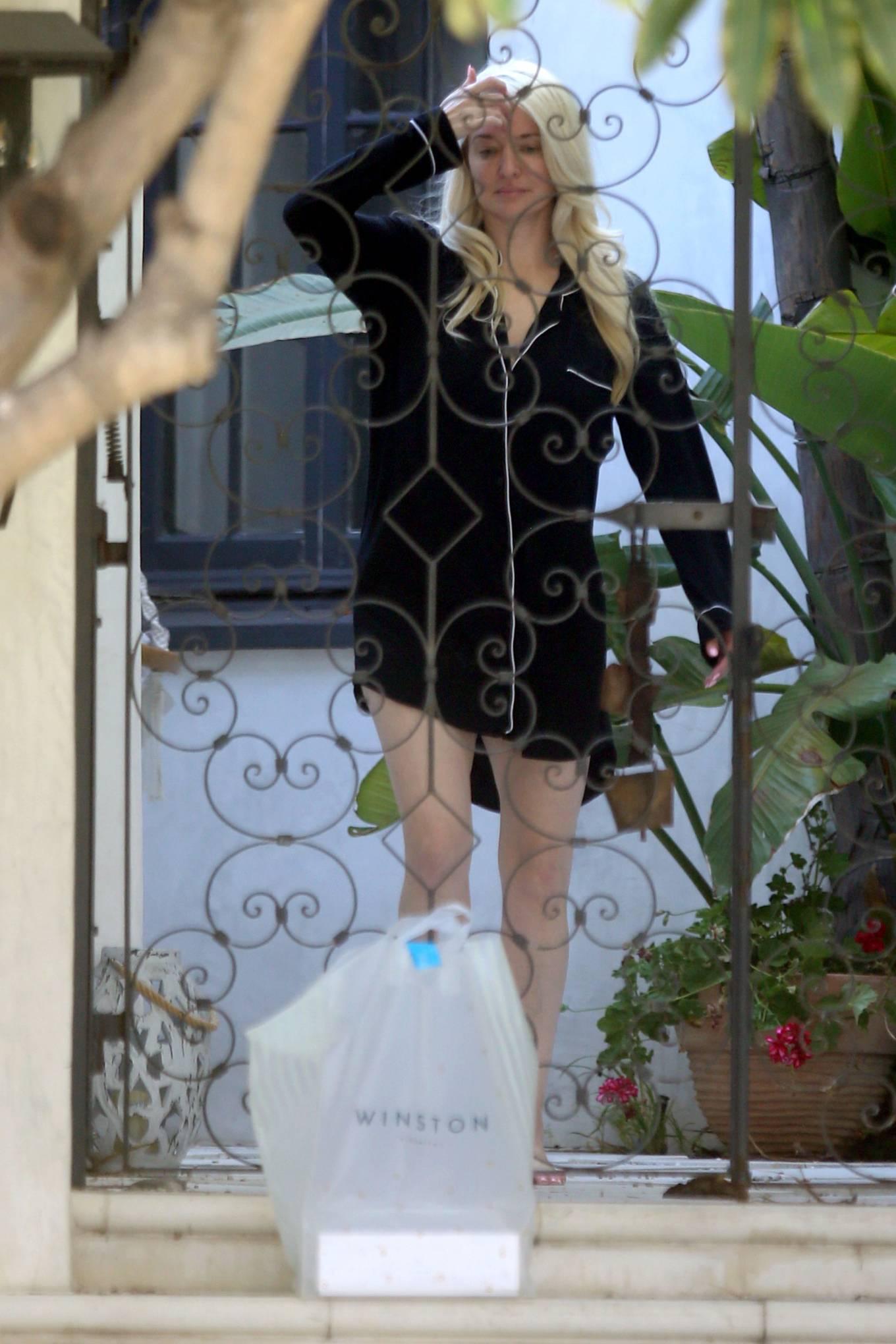 Erika Jayne 2021 : Erika Jayne – In a short nightshirt at her house in Los Angeles-26