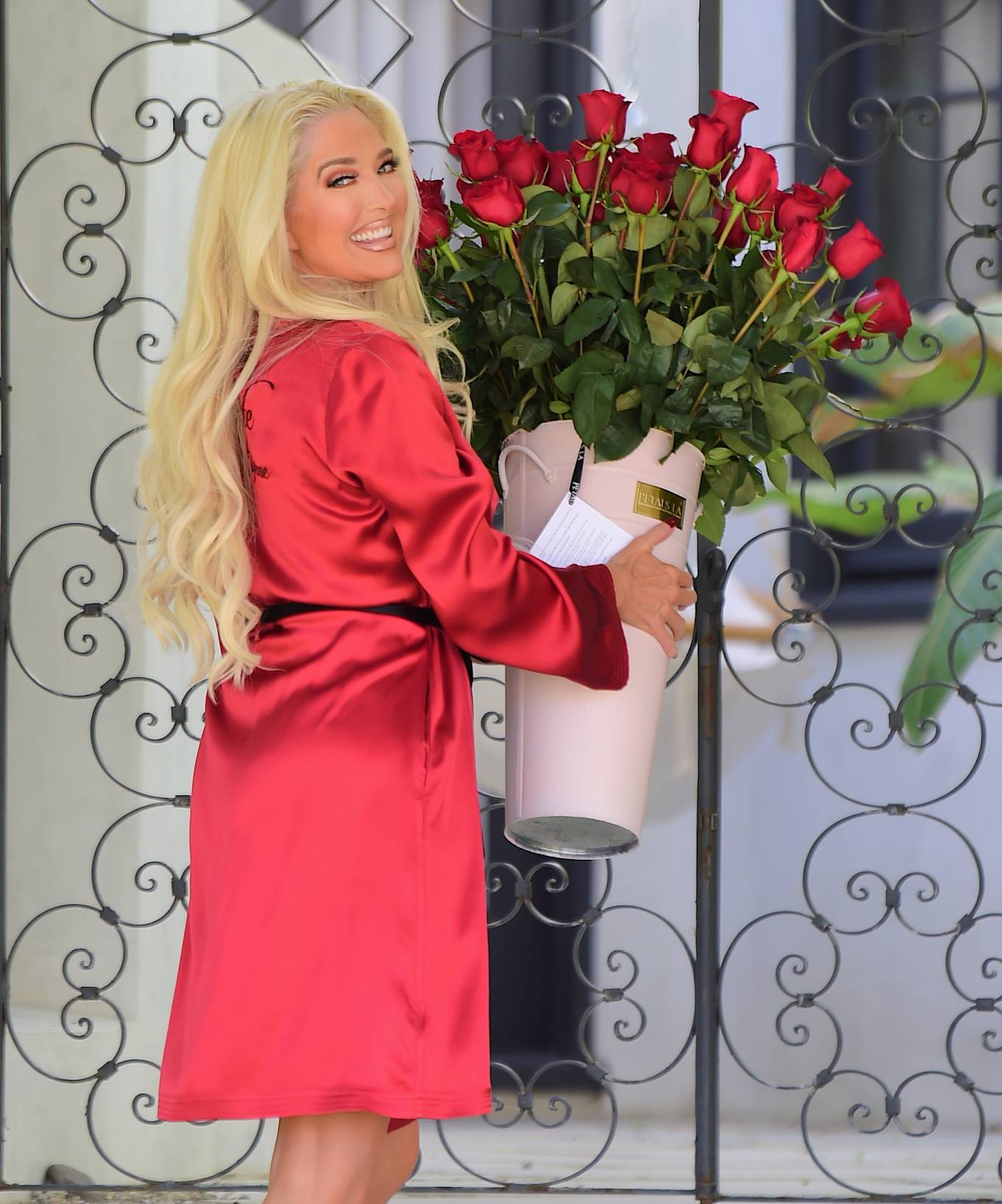 Erika Jayne - Receiving a Valentine's Day delivery outside her Los Angeles home
