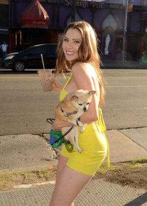 Erika Jordan in yellow outfit walking her dog in Hollywood