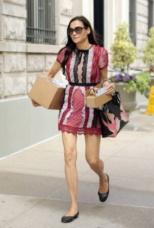 Famke Janssen - In a patchwork lace dress from the Post Office with two boxes in New York City
