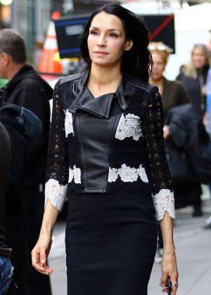 Famke Janssen in a tight black dress in New York