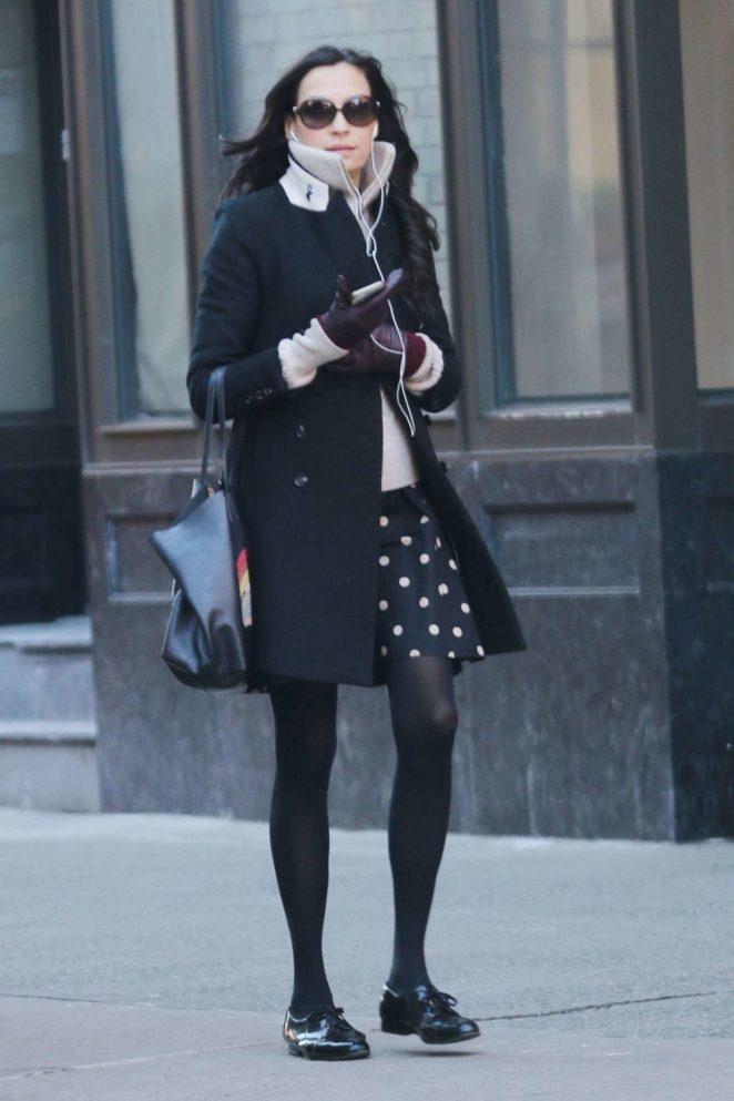 Famke Janssen in Black Coat Out in New York