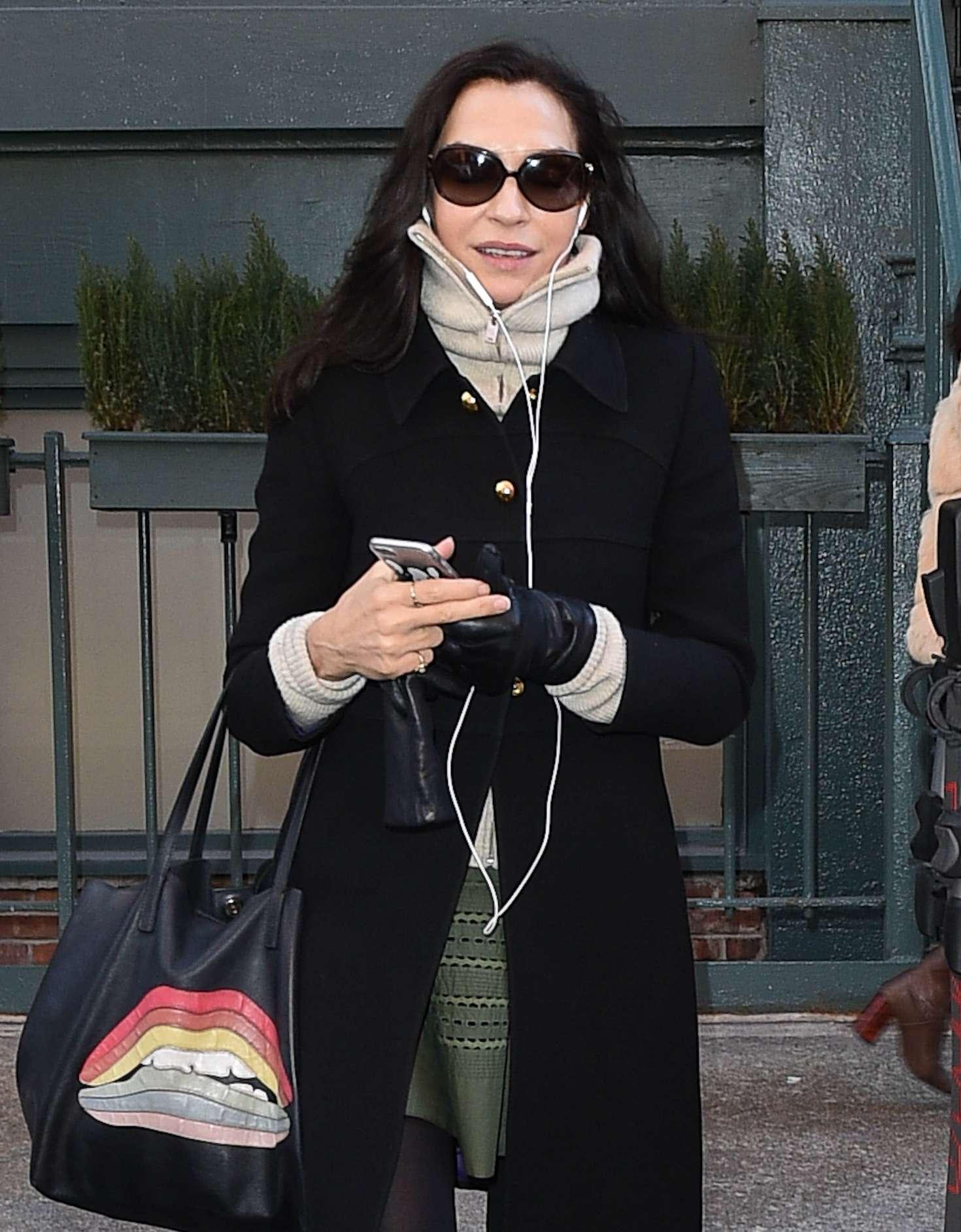 Famke Janssen in Black Coat Shopping in New York