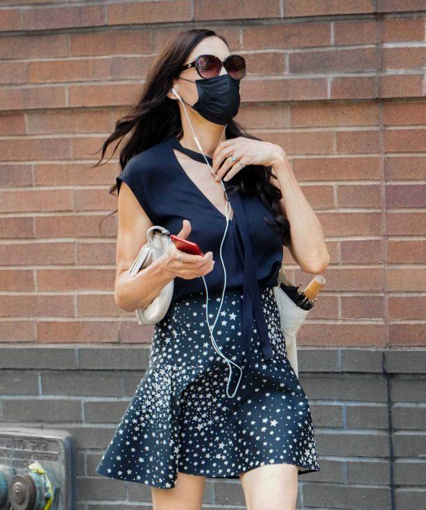 Famke Janssen - In short summer skirt out in New York City