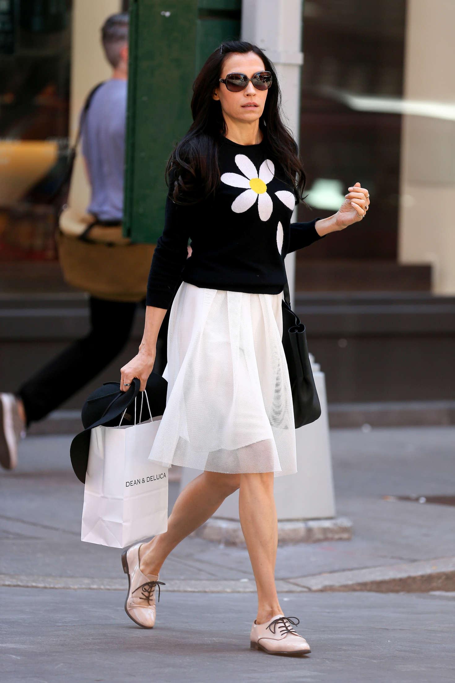 famke janssen in white skirt shopping in new york