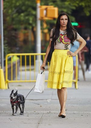 Famke Janssen in Yellow Skirt walking her dog in Soho