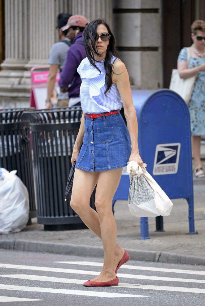 Famke Janssen - Leggy wearing a blue denim mini skirt in Soho