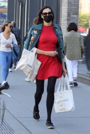 Famke Janssen - Out in a red dress for shopping around Manhattan's Soho area