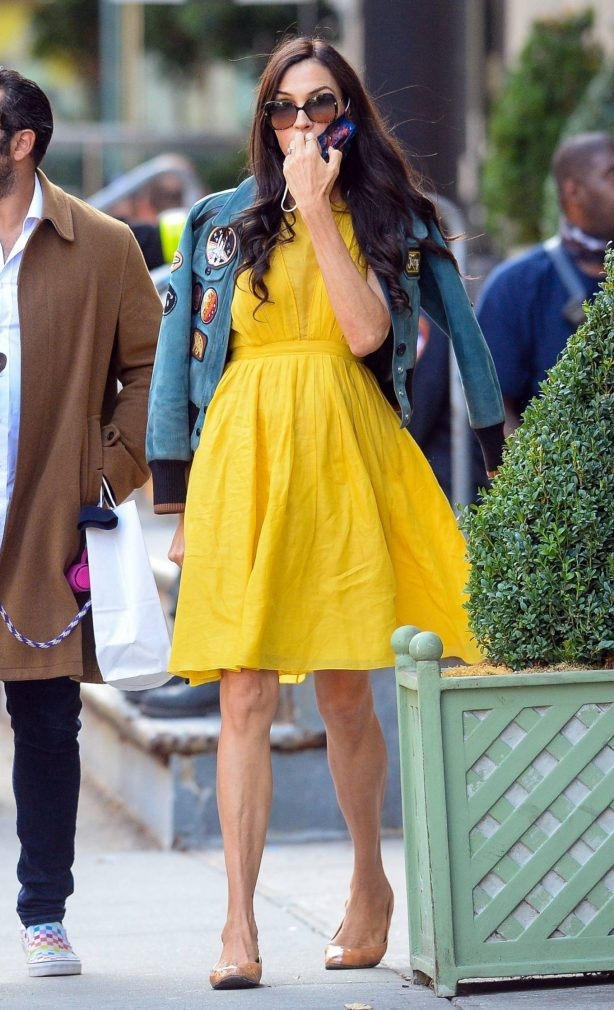 Famke Janssen - Out in a yellow dress with friends in downtown Manhattan
