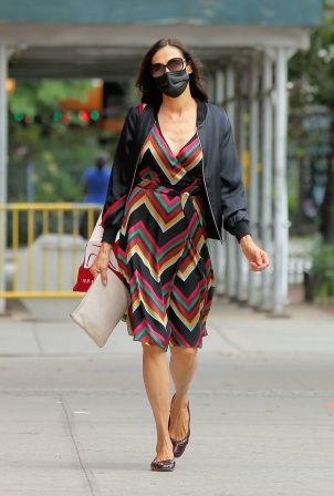 Famke Janssen - Seen walking home in a colorful dress in Soho