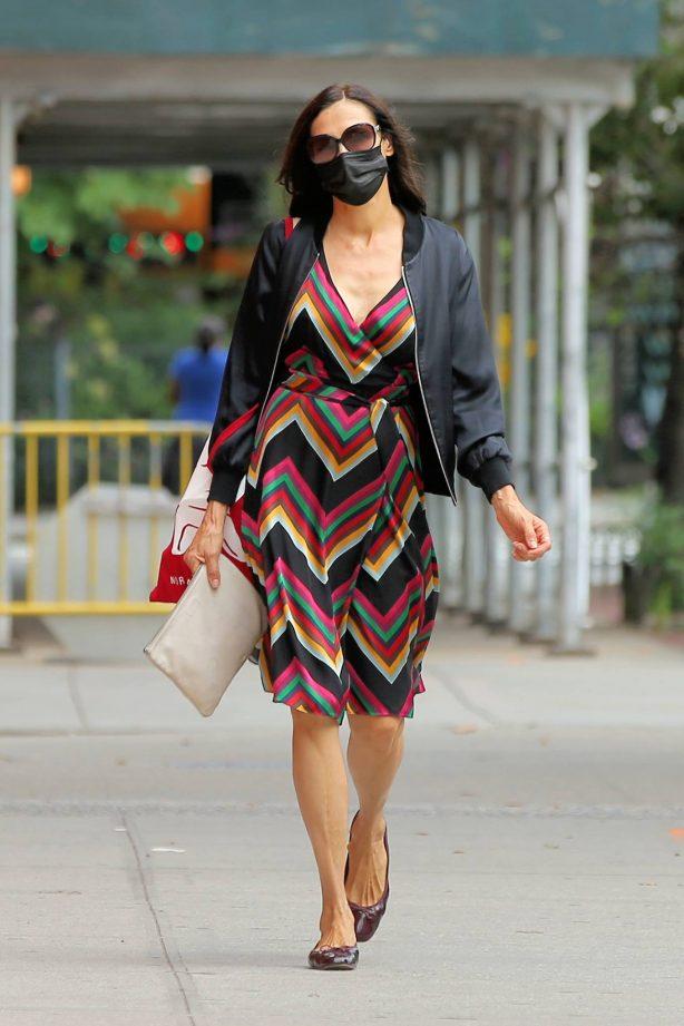 Famke Janssen - Seen walking home in a colorful dress in Soho