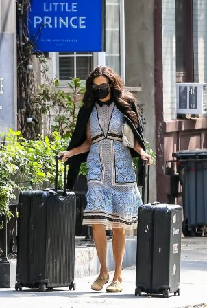 Famke Janssen - Wears long patterned dress while out in Soho