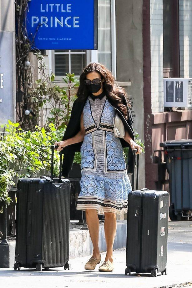 Famke Janssen - Wears long patterned dress while out in Soho
