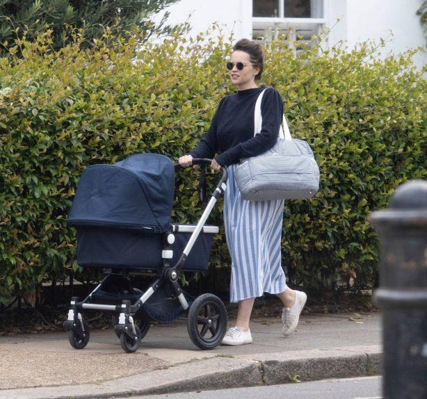 Felicity Jones - Takes her newborn for a stroll in London
