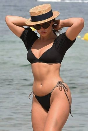Francesca Allen - In black bikini on the beach in Dubai
