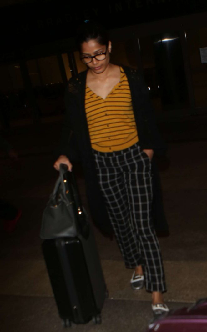 Freida Pinto - Arrives at LAX Airport in Los Angeles
