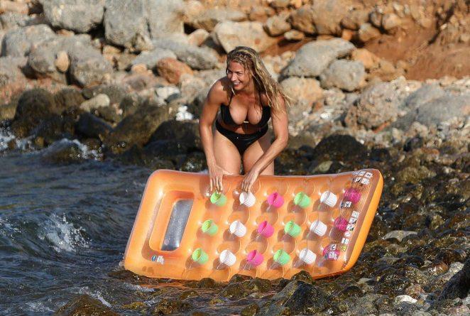 Gemma Atkinson in Black Bikini on the beach in Crete