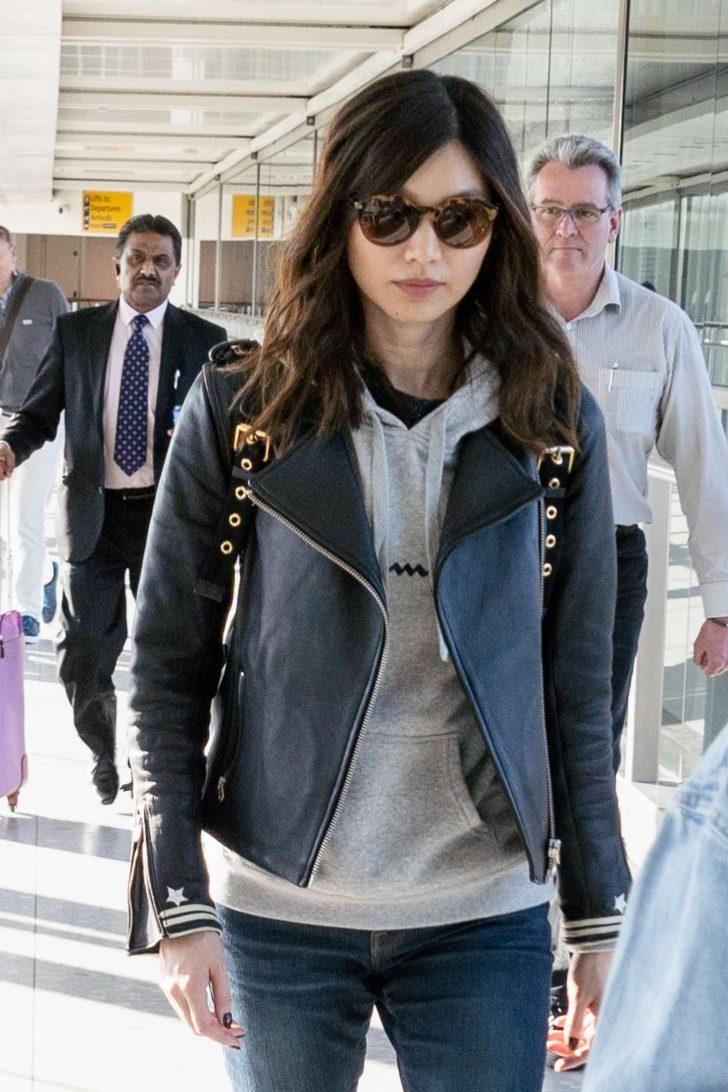 Gemma Chan at Heathrow Airport in London