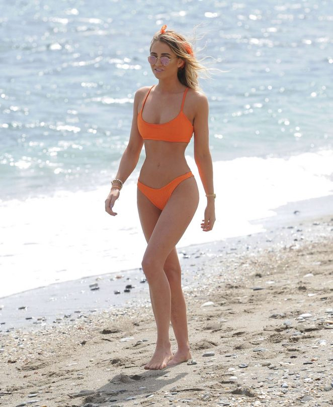 Georgia Harrison in Orange Bikini on the beach in Ibiza