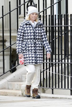 Georgia Toffolo - Wearing woolly hat and dog-tooth pattern puffa jacket in London