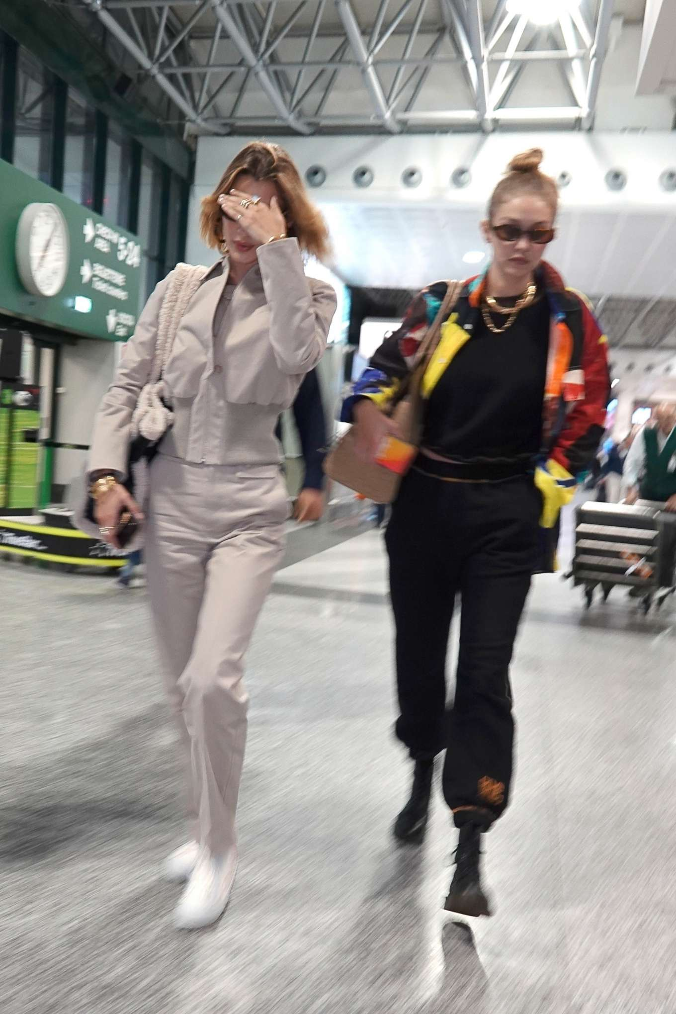 Gigi and Bella Hadid - Arrives at Milan Malpensa Airport