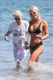 Gigi Gorgeous in Black Bikini with Nats Getty at the beach in Montecito
