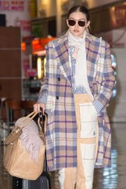 Gigi Hadid - Arrives at JFK airport with her mother in New York City