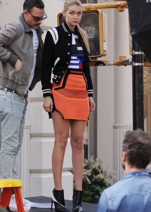 gigi hadid in orange mini skirt on photoshoot in nyc