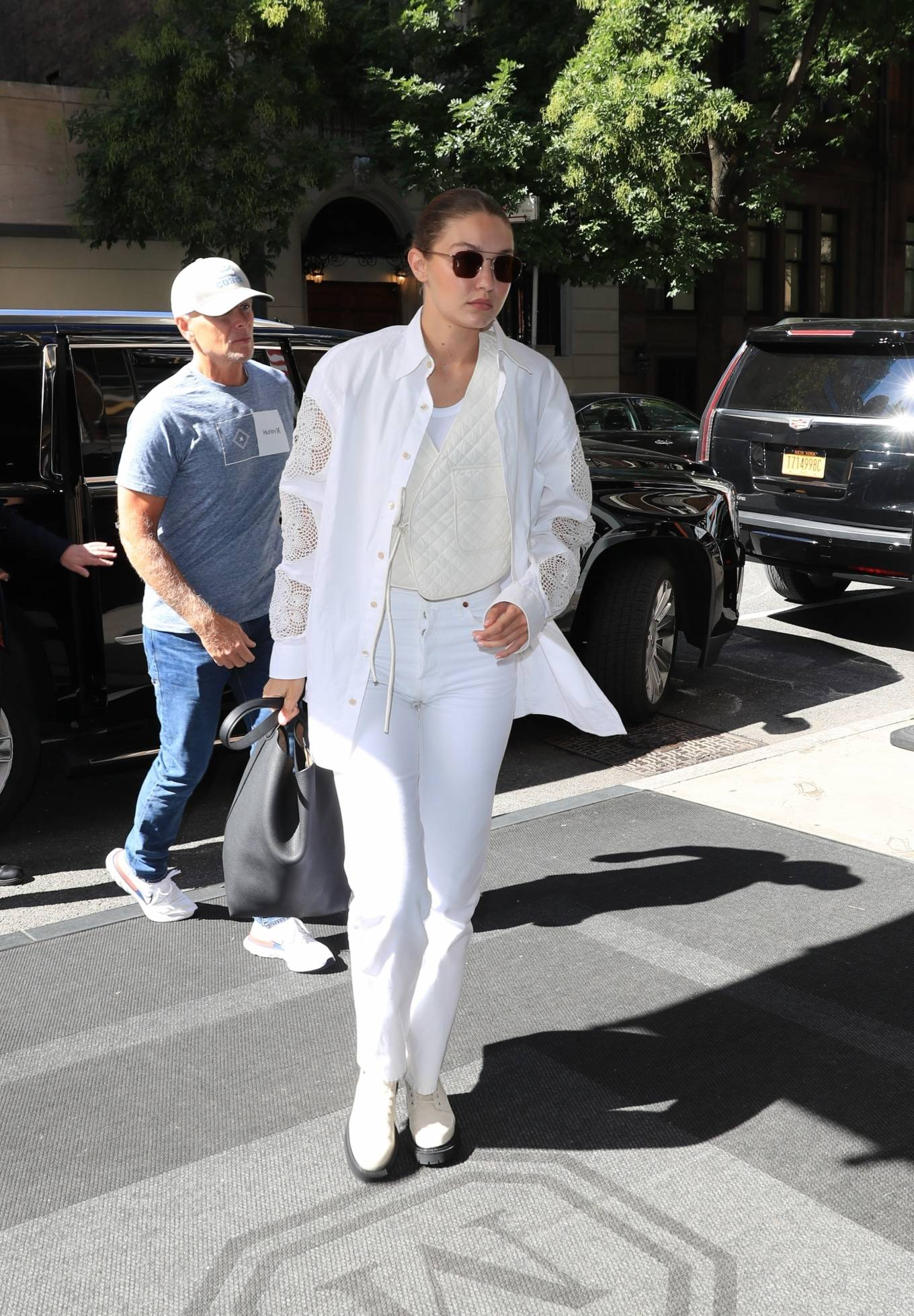 Gigi Hadid - In an all-white ensemble as she steps out during New York Fashion Week