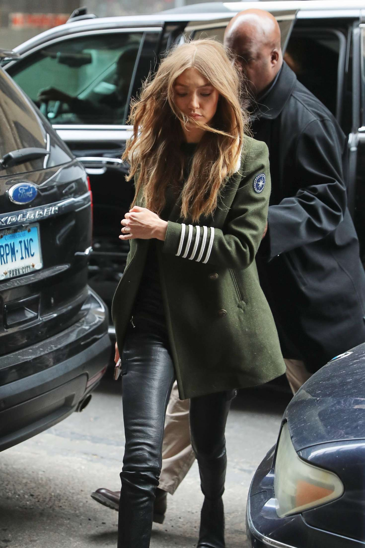 Gigi Hadid in green coat and leather pants in New York