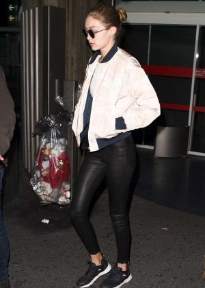 Gigi Hadid in Leather at Charles de Gaulles Airport in Paris