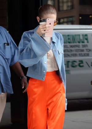 Gigi Hadid in orange trousers out in NYC