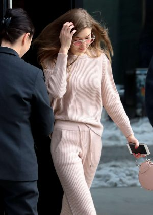 Gigi Hadid in pink leaves her apartment in NY