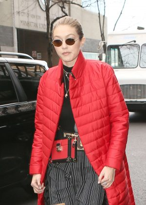 Gigi Hadid in Red Long Jacket - Leaving her apartment in NYC