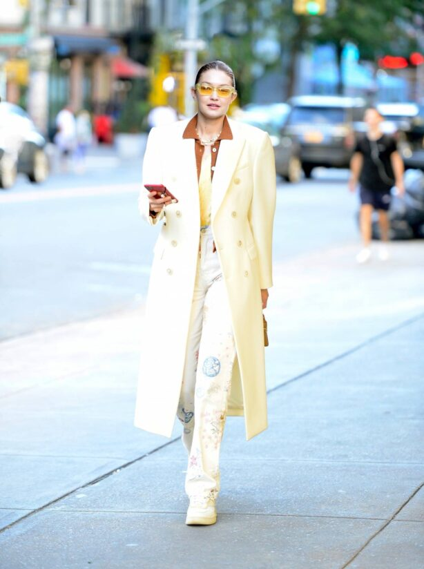 Gigi Hadid - Steps out in a white overcoat in New York