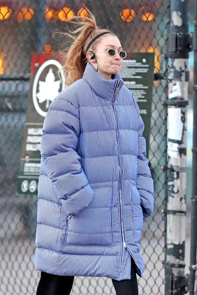 Gigi Hadid – Wearing a Pin Stripe Puffer Jacket in NYC