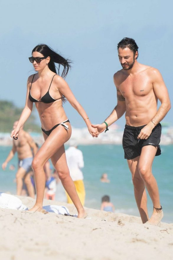Giorgia Gabriele and Andrea Grilli are seen during a beach day in Miami