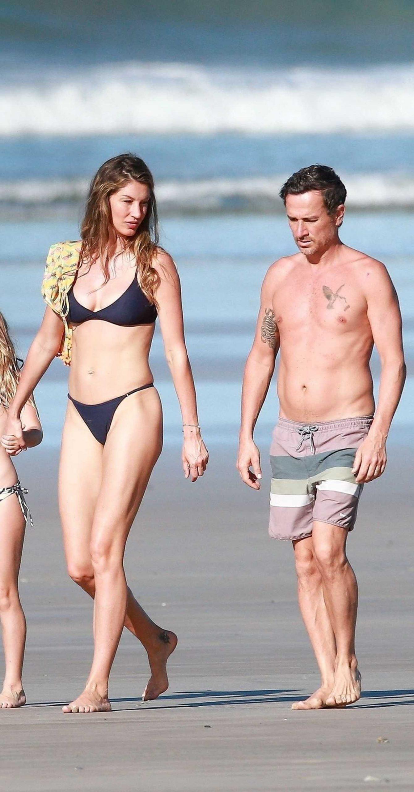 Gisele Bundchen in Black Bikini - Takes a Morning Walk on the Beach in Costa Rica