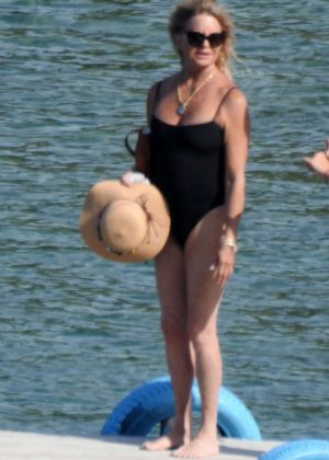 Goldie Hawn in Black Swimsuit at the beach in Skiathos