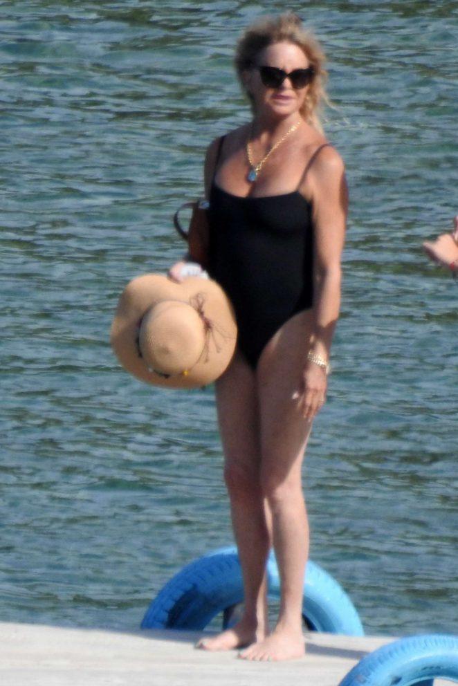 Goldie Hawn in Black Swimsuit at the beach in Skiathos